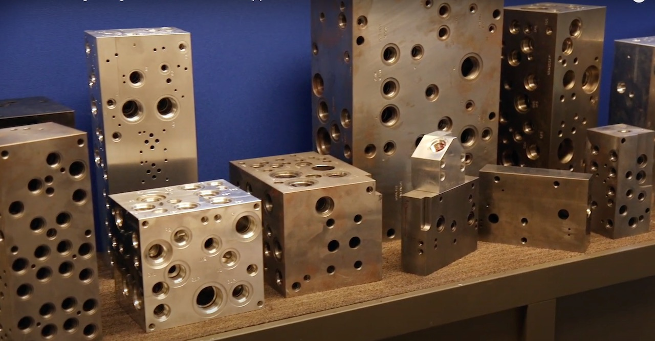 Large manifold block examples that Tomeson workers can now focus more time on with the cobot and gripper handling the smaller blocks.